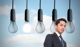 Five light bulbs in row Stock Photography