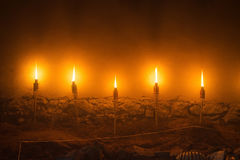 Five light fire torches, stone wall illustration of ancient medieval castle night Stock Photos