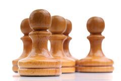 Five light wooden chess pieces alone isolated on white. An image of five light wooden chess pieces alone isolated on white royalty free stock images