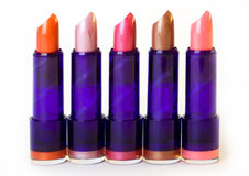 Five lipsticks. Of different colors in a row Royalty Free Stock Photography
