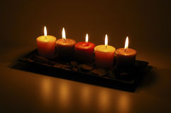 Five Lit Candles. Five burning candles arranged as a centerpiece Royalty Free Stock Photos