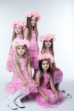 Five little girls in pink dresses and wreaths Royalty Free Stock Photo
