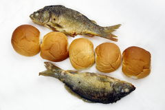 The five loaves, and the two fishes. Took the five loaves, and the two fishes stock images