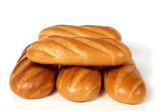 Five loaves of white bread. There are five loafs of white bread in the picture Stock Photo