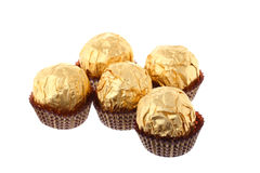 Five luxury golden sweets isolated on white Royalty Free Stock Photo