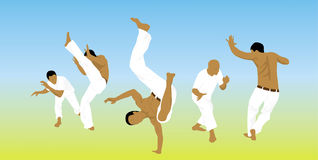 Five men are engaged capoeira on sand Stock Images