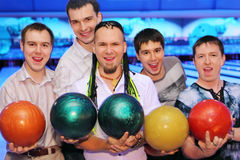 Five men hold balls in bowling club stock photography