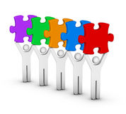 Five men with jigsaw puzzles Stock Photo