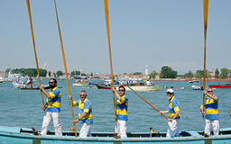 Five Men with Oars at Attention Royalty Free Stock Images