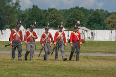 Five Men Walking in Uniform Stock Photography