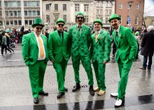 Five men wear Ireland costumes on the high place on St. Patrick`s Day Parade in Dublin, Ireland, March 18th 2015. Five men wear Ireland costumes on the high Stock Photography