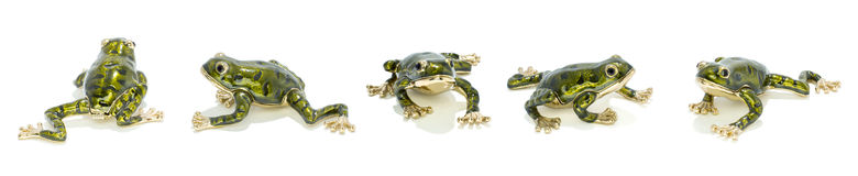 Five metal golden frogs. In diferents positions Stock Photo