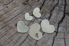 Five Metal Hearts on Wood Royalty Free Stock Images