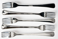 Five metallic fork Royalty Free Stock Images