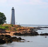 Five Mile Point lighthouse on the coast. With rocks Stock Photos