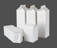 Five Milk Boxes per half liter and liter on gray Royalty Free Stock Image