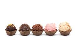Five mini cakes. On white Stock Images