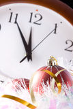 Five minutes before the new year. Holiday decorations against the backdrop of hours Stock Photos