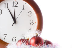 Five minutes before the new year. Holiday decorations against the backdrop of hours Royalty Free Stock Photography