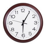 Five minutes past six on a dial. Five minutes past six on a round dial Royalty Free Stock Image