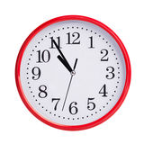Five minutes to eleven on a round dial Royalty Free Stock Images