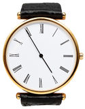 Five minutes to five o'clock on dial of wristwatch Royalty Free Stock Image