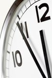 Five minutes to lunch. Photo of clock showing five minutes to noon royalty free stock photography