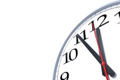 Five minutes to midnight. High resolution 3d render of an generic Wall clock and 5 minutes to midnight time isolated on white Royalty Free Stock Photos