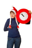 Five minutes to midnight clock and xmas girl Stock Image