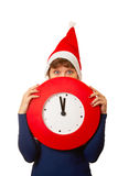 Five minutes to midnight clock and xmas girl Royalty Free Stock Photo