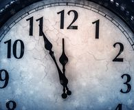 Retro clock with five minutes before twelve. Royalty Free Stock Photos