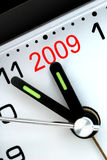 Five Minutes To Next Year. Closeup of Clock Hands, Five Minutes to Midnight and The Year 2009 Stock Images
