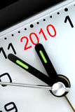 Five Minutes To Next Year. Closeup of Clock Hands, Five Minutes to Midnight and The Year 2010 Stock Photos