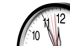 Five Minutes To Twelve. Wall clock  ,5 minutes to twelve and still ticking Stock Photos