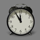 Five minutes to twelve. Analog alarm clock showing 5 to 12. Clipping path Stock Photo