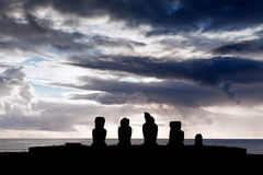 Five moai in silhouette in Easter Island. Five moai in silhouette in blue evening light in Easter Island stock photography