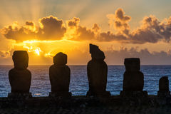 Five Moai at Sunset. Five moai on Easter Island with the sun setting behind them Stock Photos