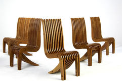 Five Modern Design  wooden Side chairs Royalty Free Stock Images