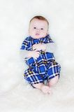 Five-months Baby Lies On A Fur Plaid Royalty Free Stock Photos