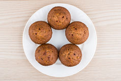 Five muffins in glass plate on table top view Royalty Free Stock Image