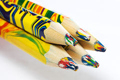 Five multi-coloured pencils Royalty Free Stock Photos