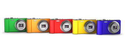 Five multicolor point and shoot photo cameras Royalty Free Stock Images