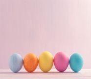 Five multicolored Easter eggs on light background Royalty Free Stock Image