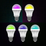Five multicolored LED energy saving light bulbs in the background of small circles. Vector Stock Images