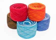 Multicolored rolls of yarn Stock Photos
