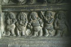 Five Musicians. Wall panel carving of musicians with various instruments, Badami, Karnataka, India, Asia Royalty Free Stock Photo