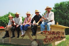 Five musicians play music. Stock Image