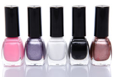 Five nail polish bottles Stock Images