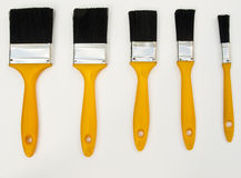 Five new paint brushes Stock Photos