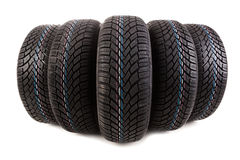 Five new tires isolated on white background Stock Photography